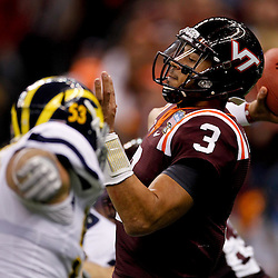 January 3, 2012; New Orleans, LA, USA; Virginia Tech Hokies quarterback Logan Thomas (3) throws as Michigan Wolverines defensive end Ryan Van Bergen (53) pressures during the first quarter of the Sugar Bowl at the Mercedes-Benz Superdome.  Mandatory Credit: Derick E. Hingle-US PRESSWIRE