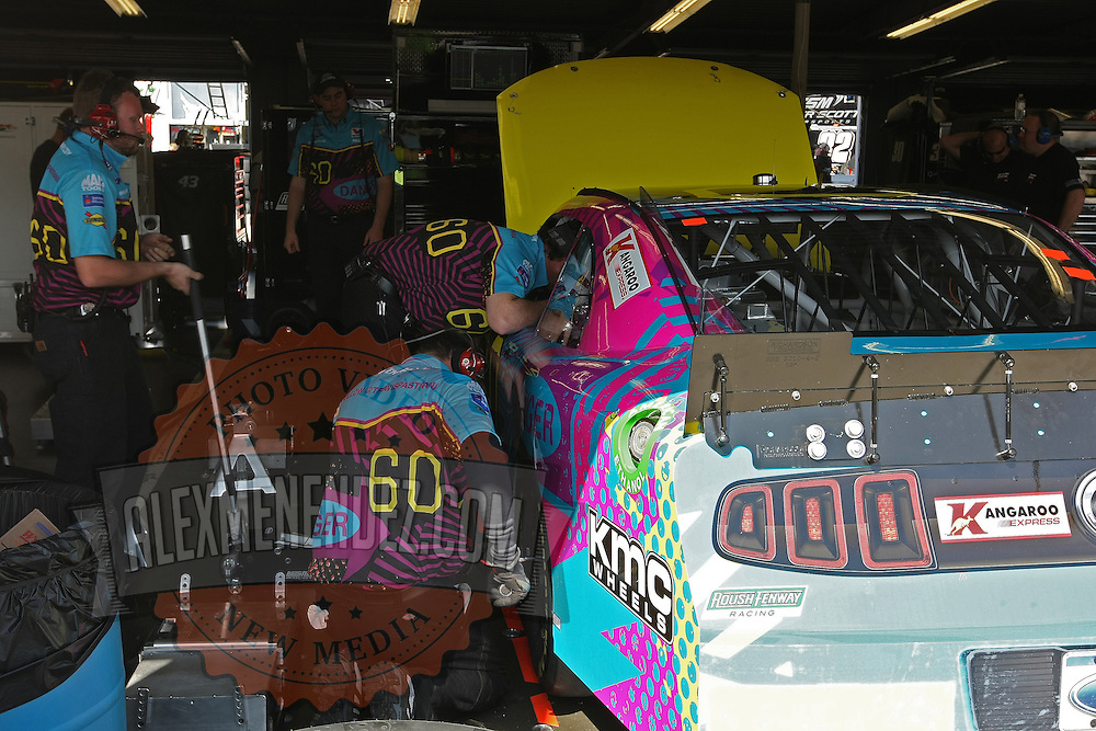 The crew of Rousch-Fenway Racing Ford driver Travis Pastrana is seen in the garage area, during a NASCAR Drive4COPD Nationwide Series practice session at Daytona International Speedway on Thursday, February 21, 2013 in Daytona Beach, Florida.  (AP Photo/Alex Menendez)
