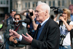 © licensed to London News Pictures. London, UK  01/05/11. Labour politician Tony Benn waits addresses several thousand people taking part in a Mayday demonstration in central London. Please see special instructions for usage rates. Photo credit should read Matt Cetti-Roberts/LNP