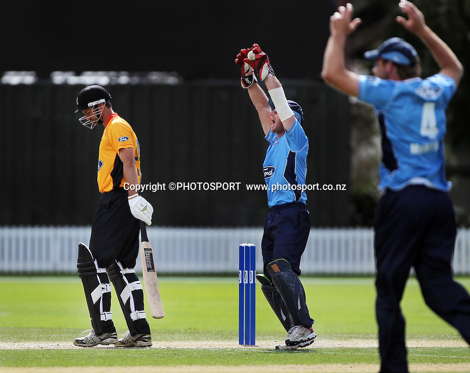 Gareth Hopkins appeals successfully for caught behind for the wicket of Grant Elliott. Auckland Aces v Wellington Firebirds,   Ford Trophy one day game held at Burt Sutcliffe Oval, Lincoln, Friday 25 November 2011. Photo : Joseph Johnson / photosport.co.nz