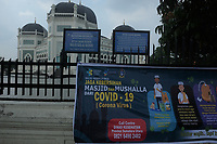 Medan, Indonesia, Friday, March 20, 2020: An warning about the deadly Corona virus (Covid-19) seen at the yard of Al Mashun great mosque in Medan, North Sumatra, Indonesia on Marc 20, 2020. Respective homes is the isolation place as adaptation choose for Indonesian muslims during Friday worship.