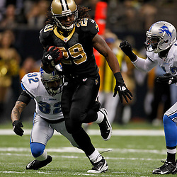 January 7, 2012; New Orleans, LA, USA; New Orleans Saints running back Chris Ivory (29) runs from Detroit Lions cornerback Aaron Berry (32) during the 2011 NFC wild card playoff game at the Mercedes-Benz Superdome. Mandatory Credit: Derick E. Hingle-US PRESSWIRE