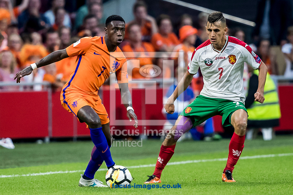 Quincy Promes of Netherlands (L), Georgi Kostadinov of Bulgaria (R) during the 2018 FIFA World Cup Qualifying match at Amsterdam Arena, Amsterdam<br /> Picture by Joep Joseph Leenen/Focus Images Ltd +316 5261929<br /> 03/09/2017<br /> ***NETHERLANDS OUT***