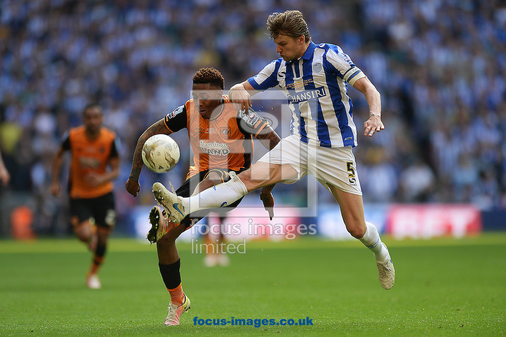 Abel Hernandez of Hull City does battle with Glenn Loovens of Sheffield Wednesday during the Sky Bet Championship Play-off Final between Hull City and Sheffield Wednesday at KC Stadium, Hull<br /> Picture by Richard Blaxall/Focus Images Ltd +44 7853 364624<br /> 28/05/2016