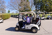 Justin Thomas drives off with Brian Costa, a reporter for the Wall Street Journal, for an interview at the 18th green as he hosts the Strategic Communications/Justin Thomas Junior Championship presented by Phocus at Harmony Landing Country Club Friday, April 20, 2018, in Goshen, Ky. (Photo by Brian Bohannon)
