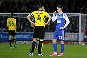 Burton Albion defender John Mousinho (4) and Ipswich Town striker Tom Lawrence (27) discuss an incident with referee Oliver Langford during the EFL Sky Bet Championship match between Burton Albion and Ipswich Town at the Pirelli Stadium, Burton upon Trent, England on 14 April 2017. Photo by Richard Holmes.