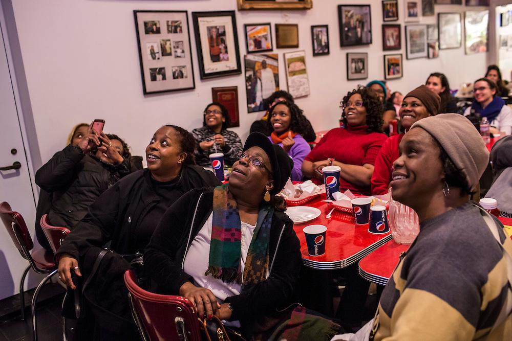 Chicago-based members of Don't Leave Me Ministry gather at Ben's Chili Bowl, a local institution which President Barack Obama has visited, to watch his Inaugural Ball on television on Monday, January 21, 2013 in Washington, DC.