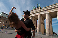 "It was once the site of triumphal entries of armies, then was isolated, almost forgot, too close to the wall, Now the Brandenburg door is the center of the new Berlin. These two new Berliners of Turkish origin trying steps of colombian ""cumbia""  are a symbol of cosmopolitanism that of Europe's capital bought back over the past twenty years."