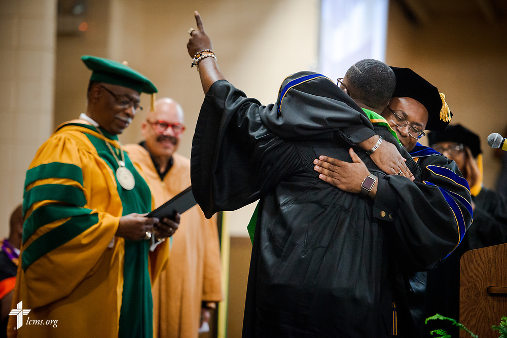 Dr. Glenn King, dean of Business and Computer Information Systems at the college, hugs a graduate during the 92nd and final Commencement Exercises on Saturday, April 28, 2018, in the Julius and Mary Jenkins Center at Concordia College Alabama in Selma, Ala. LCMS Communications/Erik M. Lunsford