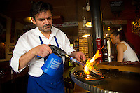 Paris, France - July 17, 2014: Chef Stéphane Jégo sears a fish with a blowtorch at L'Ami Jean in the 7th arrondissement in Paris. Jégo brings theatrics and passion to the Basque restaurant's absurdly small kitchen.  CREDIT: Chris Carmichael for The New York Times