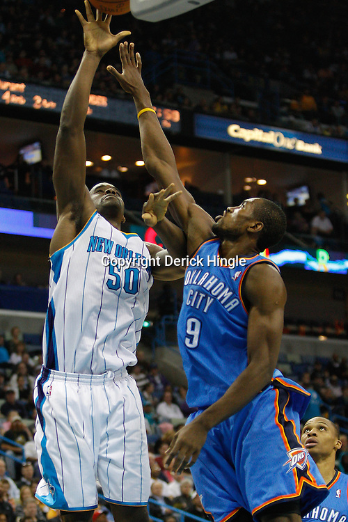 January 24,  2011; New Orleans, LA, USA; New Orleans Hornets center Emeka Okafor (50) shoots over Oklahoma City Thunder power forward Serge Ibaka (9) during the second quarter at the New Orleans Arena. Mandatory Credit: Derick E. Hingle