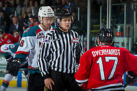KELOWNA, CANADA - APRIL 8: Linesman Dustin Minty gets between Carsen Twarynski #18 of the Kelowna Rockets and Alex Overhardt #17 of the Portland Winterhawks at the face off on April 8, 2017 at Prospera Place in Kelowna, British Columbia, Canada.  (Photo by Marissa Baecker/Shoot the Breeze)  *** Local Caption ***
