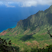 This photo of the Kalalau valley was taken on the northwestern side of the island of Kauai. The Kalalau valley is part of the Na Pali coast.