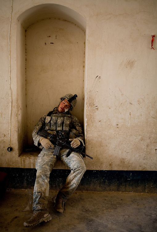 Specialist Shaun Hanna of the 82nd Airborne's 1/508 Parachute Infantry Regiment, Alpha Company, Third Platoon nods off while taking a break from searching homes after staging a nighttime air assault into Sangin, Helmand province, the largest air assault in Afghanistan since the beginning of the war, on Thursday, April 5, 2007.