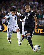 Mexico defender Luis Rodriguez (21) dribbles Cuba midfielder Luis Paradela (23) during a game between Mexico and Cuba in a CONCACAF Gold Cup soccer match in Pasadena, Calif., Saturday, June 15, 2019. Mexico defeated Cuba 7-0. (Ed Ruvalcaba/Image of Sport)
