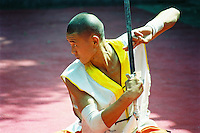 """China, Henan, 2007. With discipline finely honed over thousands of years, Shaolin Temple monks practice""""gong fu,"""" originally conceived as a defensive art in less stable times.."""