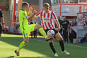 Jay Harris and Asa Hall during the Vanarama National League match between Cheltenham Town and Tranmere Rovers at Whaddon Road, Cheltenham, England on 26 September 2015. Photo by Antony Thompson.