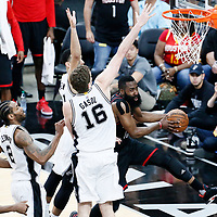 01 May 2017: Houston Rockets guard James Harden (13) goes around San Antonio Spurs center Pau Gasol (16) and San Antonio Spurs guard Danny Green (14) during the Houston Rockets 126-99 victory over the San Antonio Spurs, in game 1 of the Western Conference Semi Finals, at the AT&T Center, San Antonio, Texas, USA.