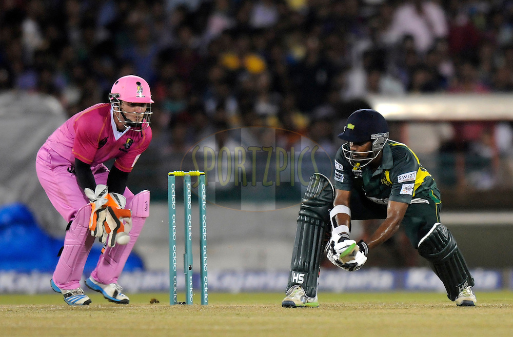 Seekkuge Prasanna of Southern Express bats during the qualifier 1 match of the Oppo Champions League Twenty20 between the Northern Knights and the Southern Express held at the Chhattisgarh International Cricket Stadium, Raipur, India on the 13th September 2014<br /> <br /> Photo by:  Pal Pillai / Sportzpics/ CLT20<br /> <br /> <br /> Image use is subject to the terms and conditions as laid out by the BCCI/ CLT20.  The terms and conditions can be downloaded here:<br /> <br /> http://sportzpics.photoshelter.com/gallery/CLT20-Image-Terms-and-Conditions-2014/G0000IfNJn535VPU/C0000QhhKadWcjYs