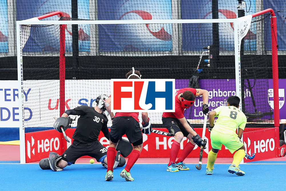 LONDON, ENGLAND - JUNE 24: Wenhui E of China scores his sides first goal during the 5th-8th place match between Canada and China on day eight of the Hero Hockey World League Semi-Final at Lee Valley Hockey and Tennis Centre on June 24, 2017 in London, England.  (Photo by Alex Morton/Getty Images)