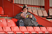 Accrinton stanley fam weighs up the game during the Sky Bet League 2 match between Accrington Stanley and Newport County at the Fraser Eagle Stadium, Accrington, England on 14 November 2015. Photo by Mark Pollitt.