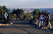 Japanese tourists at Mather Point, Bright Angel Trail, Grand Canyon National Park, Arizona..Media Usage:.Subject photograph(s) are copyrighted Edward McCain. All rights are reserved except those specifically granted by McCain Photography in writing...McCain Photography.211 S 4th Avenue.Tucson, AZ 85701-2103.(520) 623-1998.mobile: (520) 990-0999.fax: (520) 623-1190.http://www.mccainphoto.com.edward@mccainphoto.com