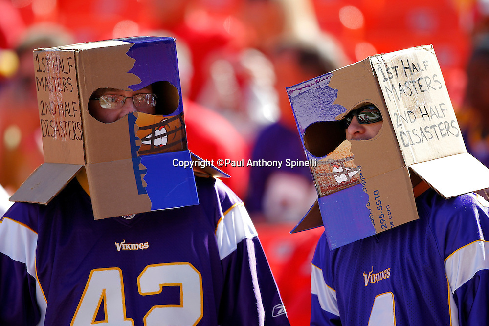 Minnesota Vikings fans wear boxes that show the 2011 Vikings propensity for blowing first half leads during the NFL week 4 football game against the Kansas City Chiefs on Sunday, October 2, 2011 in Kansas City, Missouri. The Chiefs won the game 22-17. ©Paul Anthony Spinelli