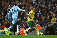 Picture by Paul Chesterton/Focus Images Ltd.  07904 640267.03/12/11.Anthony Pilkington of Norwich and Yaya Touré of Man City in action during the Barclays Premier League match at the Etihad Stadium, Manchester.