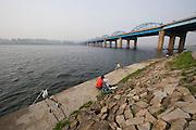 Seocho-gu, Han River. Hangang Park. Fishermen at Dongjak Bridge.