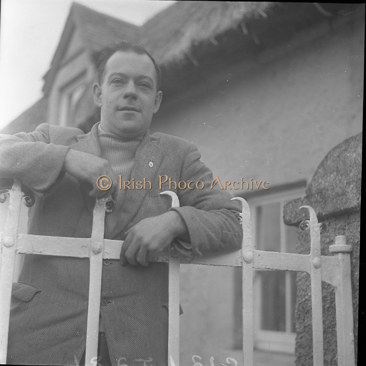 Lead Mines at Loughrea..1962..08.01.1962..01.08.1962..8th January 1962..Prospecting started in Loughrea in what is thought to be lead deposits beneath the lands of several small farms in the area...Picture shows farmer Eamon O'Reilly taking an interest in the drilling operation at his farm in Loughrea.