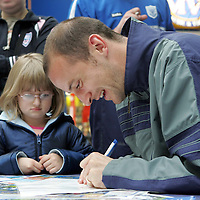 St Johnstone player Paul Sheerin signing autographs during a meet the players event in the St Johns Shopping Centre in Perth.<br />Picture by Graeme Hart.<br />Copyright Perthshire Picture Agency<br />Tel: 01738 623350  Mobile: 07990 594431