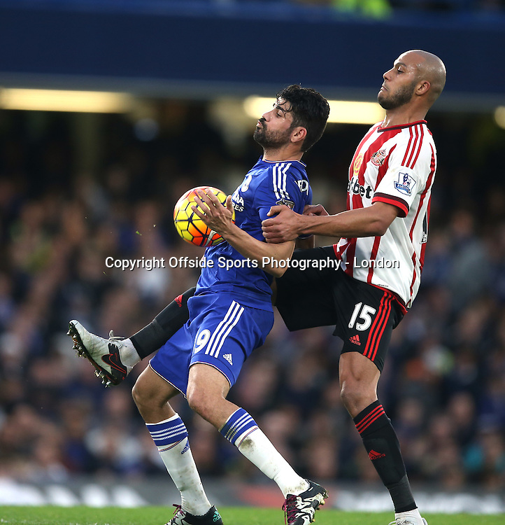 19 December 2015 Premier League Football - Chelsea v Sunderland : Diego Costa of Chelsea is challenged by Younes Kaboul.<br /> <br /> Photo: Mark Leech