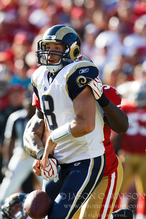 November 14, 2010; San Francisco, CA, USA;  St. Louis Rams quarterback Sam Bradford (8) fumbles the ball after being hit from behind by San Francisco 49ers linebacker Patrick Willis (back) during the first quarter at Candlestick Park.