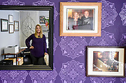 Ashley Anson, an attorney, is seen in the reflection of a mirror in her office along with photos of her with South Dakota Chief Justice David E. Gilbertson in Wessington Springs.  (Matt Gade / Republic)