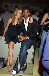 AYESHA MAKIM and STEVE WOOD at a fashion show by ISSA held at Cocoon, 65 Regent Street, London on 21st September 2005.<br /><br />NON EXCLUSIVE - WORLD RIGHTS