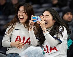 LONDON, ENGLAND - Saturday, January 11, 2020: Two Tottenham Hotspur supporters during the FA Premier League match between Tottenham Hotspur FC and Liverpool FC at the Tottenham Hotspur Stadium. (Pic by David Rawcliffe/Propaganda)