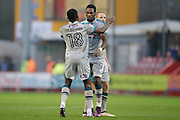 Omar Bogle(9) and Tom Bolarinwa celebrate after scoring the levelling goal with minutes to spare in the first half during the EFL Sky Bet League 2 match between Crawley Town and Grimsby Town FC at the Checkatrade.com Stadium, Crawley, England on 26 November 2016. Photo by Jarrod Moore.