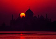 Taj Mahal at sunrise from Jumna riverbank, Agra, India