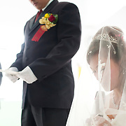 Bride and groom exchange wedding vows in christian church wedding. Namasiya Township, Kaoshiung County, Taiwan