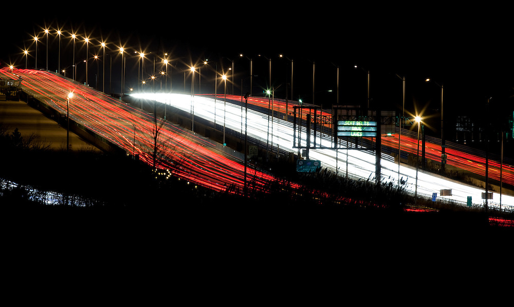 The Driscoll Bridge photographed at night with a trail of vehicle lights is a toll bridge on the Garden State Parkway in the U.S. state of New Jersey spanning the Raritan River near its mouth in Raritan Bay. The bridge connects the Middlesex County communities of Woodbridge Township on the north with Sayreville on the south. With a total of 15 lanes, it is the widest bridge in the worldThe northbound lanes of the bridge were opened to the public without fanfare on July 30, 1954.[1] The bridge was formally renamed in 1974 for former Governor of New Jersey Alfred E. Driscoll, who advocated for and oversaw the construction of the Garden State Parkway, as well as for the New Jersey Turnpik