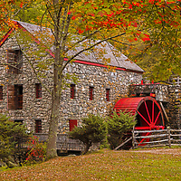 Brilliant New England fall foliage at the historic Wayside Inn Grist Mill. This local New England landmark is in Sudbury, Massachusetts. <br />