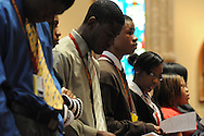 """Students from Christ the King Jesuit College Prep in Chicago join fellow Catholic high school students from the dioceses of Chicago, Rockford and Joliet during a mass at Holy Name Cathedral to focus on promoting service leadership in the church under the theme """"A Call To Serve""""."""