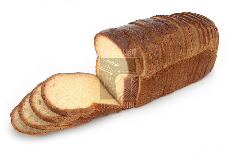 Loaf of sliced white bread on a white background