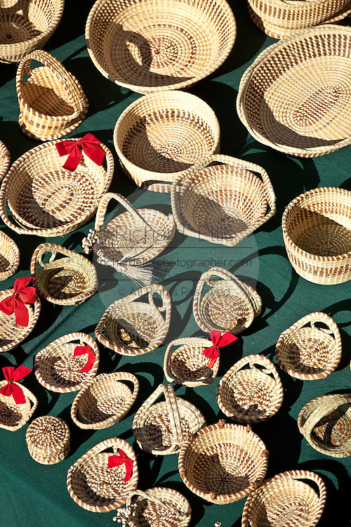 Traditional Gullah sweetgrass baskets on display in Charleston, SC.