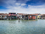 """06 OCTOBER 2014 - GEORGE TOWN, PENANG, MALAYSIA: One of the """"clan jetties"""" in George Town (also Georgetown), the capital of the state of Penang in Malaysia. The """"clan jetties"""" are the traditional homes of Chinese people who originally settled in the area centuries ago. Named after Britain's King George III, George Town is located on the north-east corner of Penang Island. The inner city has a population of 720,202 and the metropolitan area known as George Town Conurbation which consists of Penang Island, Seberang Prai, Kulim and Sungai Petani has a combined population of 2,292,394, making it the second largest metropolitan area in Malaysia. The inner city of George Town is a UNESCO World Heritage Site and one of the most popular international tourist destinations in Malaysia.      PHOTO BY JACK KURTZ"""
