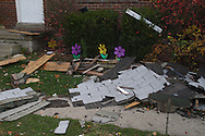 Debris from what appears to be a gas-line explosion on Wayne Drive in Fairborn landed across the street, Saturday, November 12, 2011..