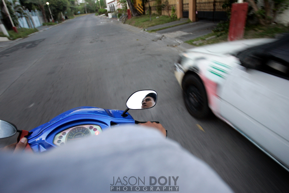 Jonathan Era on scooter driving around Paranaque Philippines, BF Homes