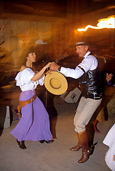 Couple enjoying a square-dance.