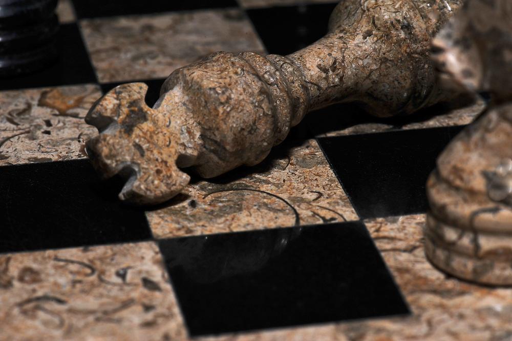 A fallen king on the battlefield of chess