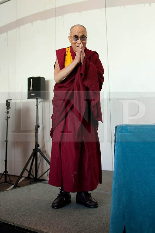 © Licensed to London News Pictures. 15/06/2012. Salford , UK . The Dalai Lama visits The Lowry Hotel in Salford , Greater Manchester , as part of his 10 day tour of the UK . Photo credit : Joel Goodman/LNP